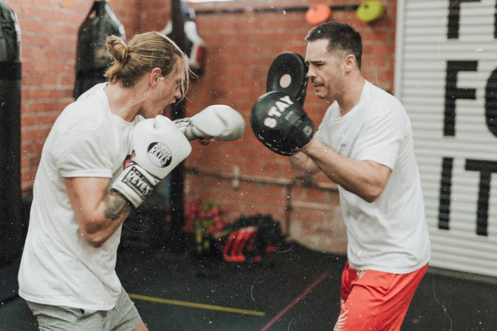 Two people boxing